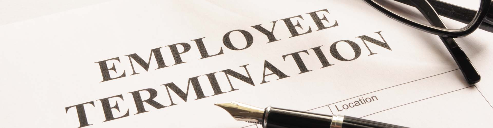Wrongful termination printed on paper with pen on top of paper