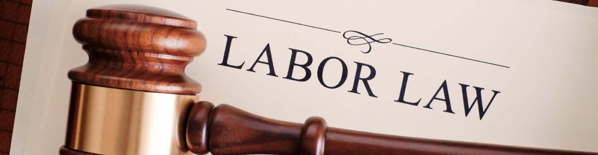 Labor law printed on paper in front of judges gavel